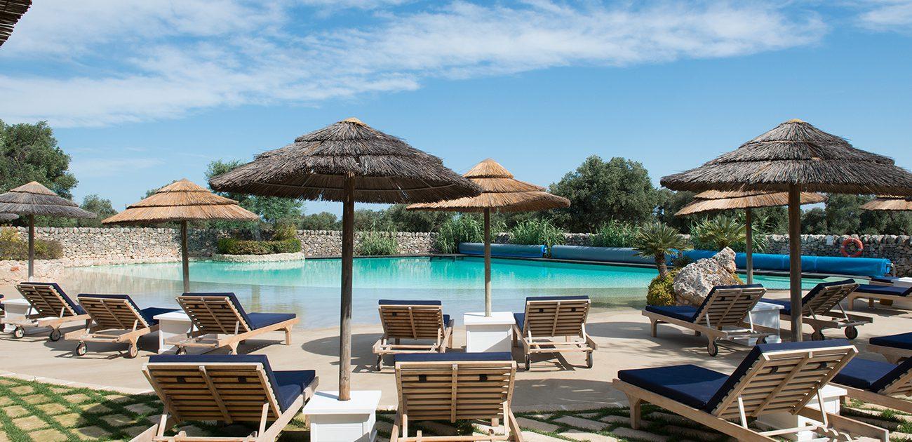 Deckchairs by the pool – Masseria Torre Coccaro, Puglia